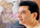 Kirit Bhai Ji with Lord Krishan image, gray and orange color